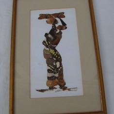 Adevarata arta realizata din aripi de fluturi, reprezentand o negresa, arta africana - Arta din Africa