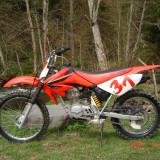 Vand (sau schimb cu ATV) motocicleta Enduro marca HONDA CRF100 F